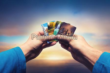 male hands lolding seasons cards
