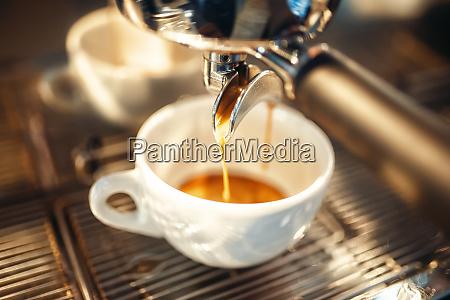 coffee machine pours foam into the