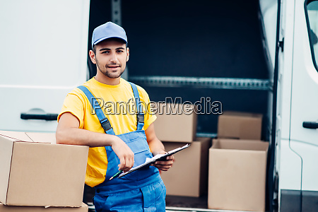 workman or courier holds carton box