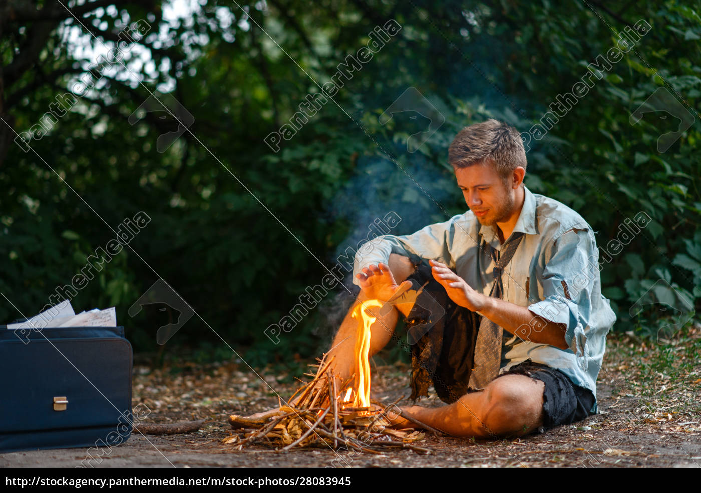 alone, businessman, warms, by, the, fire - 28083945