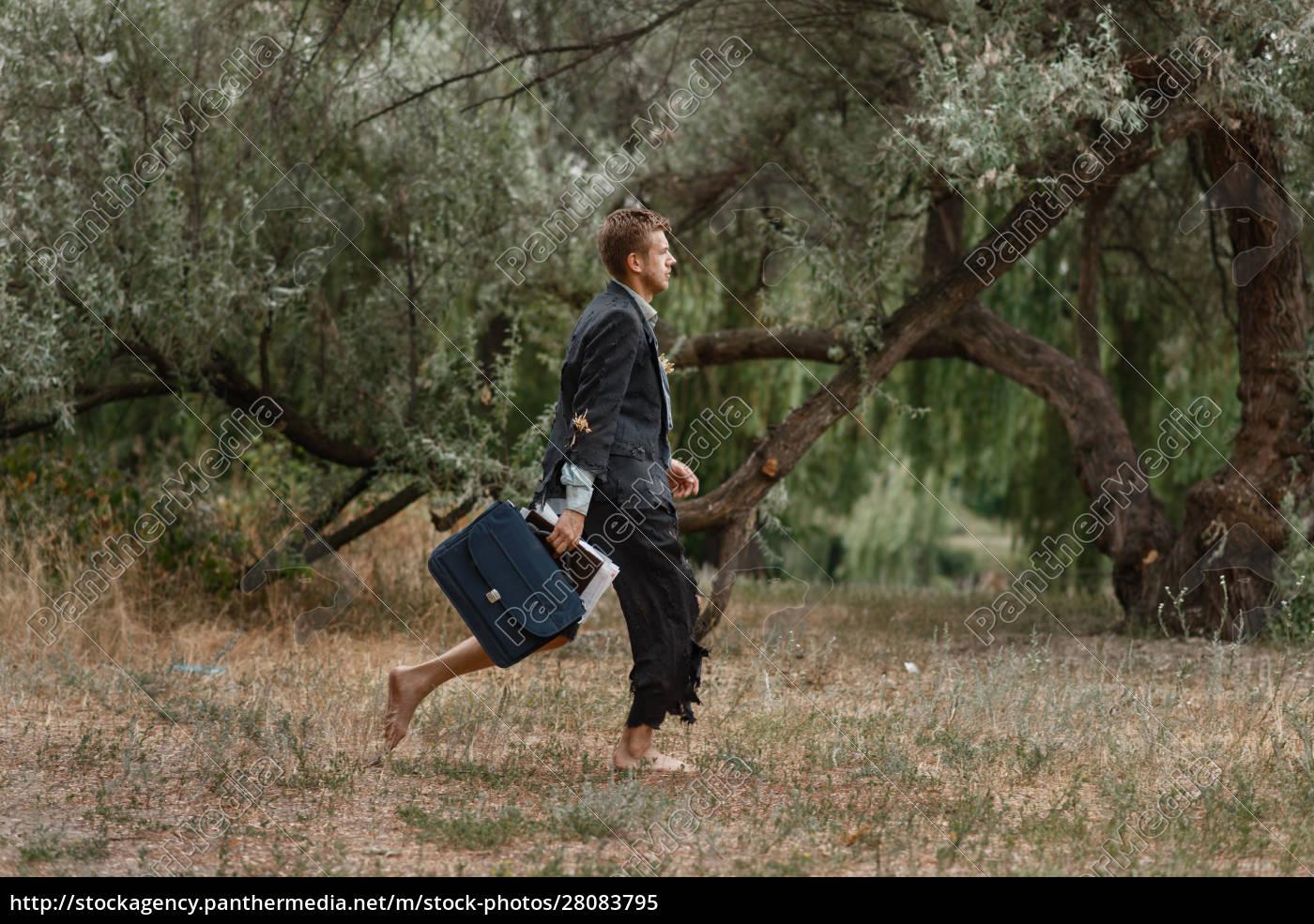 businessman, in, torn, suit, walking, on - 28083795