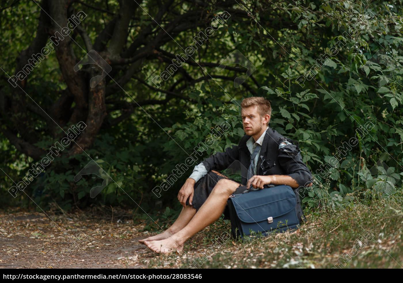businessman, sitting, on, the, ground, on - 28083546