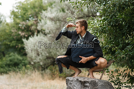 businessman, sitting, on, the, stone, , lost - 28083597