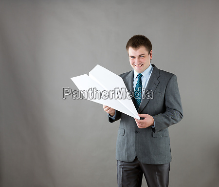 businessman, with, paper, plane, in, studio - 28083727