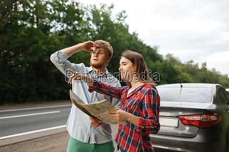 car, tourists, with, map, having, quarrel, - 28083475