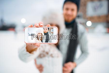 happy, love, couple, makes, selfie, on - 28083863