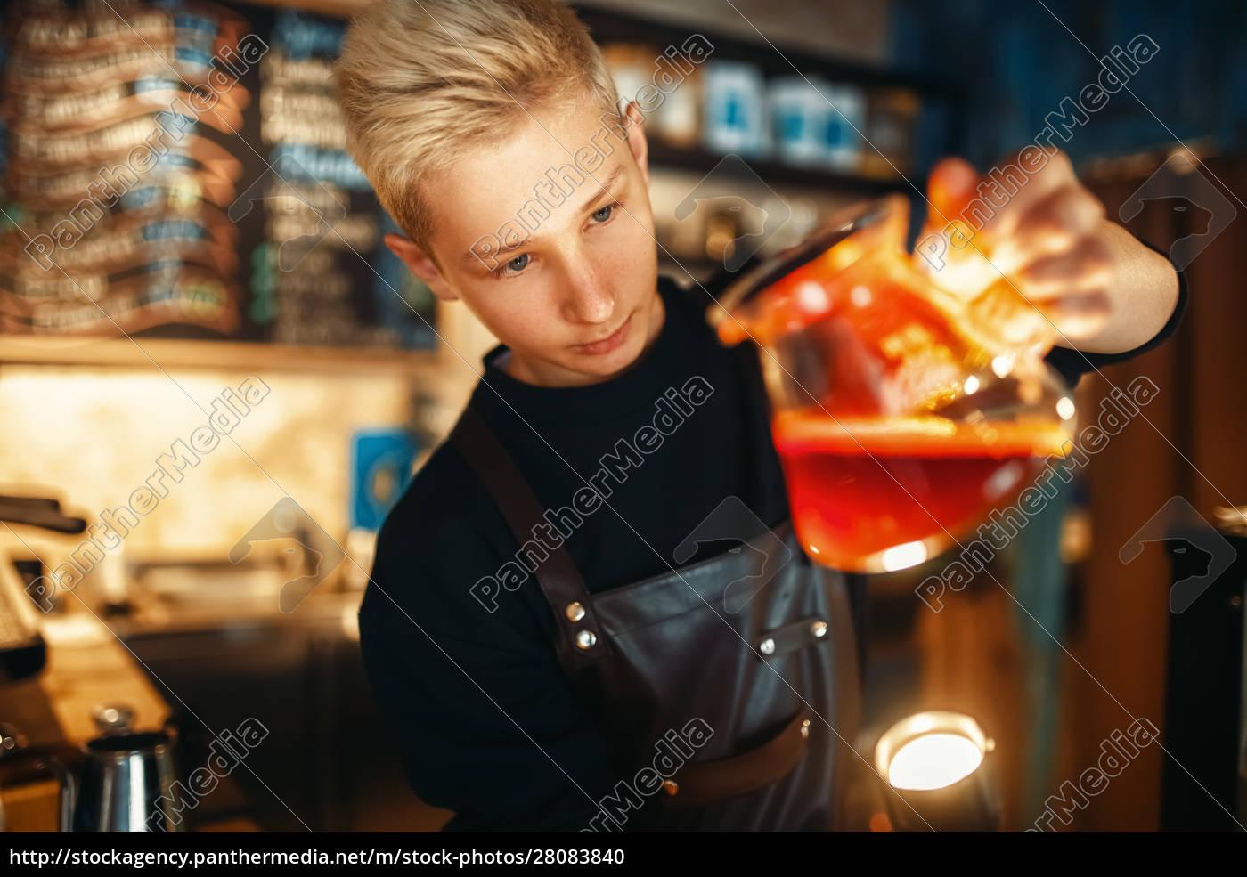 male, barista, checks, the, sediment, in - 28083840