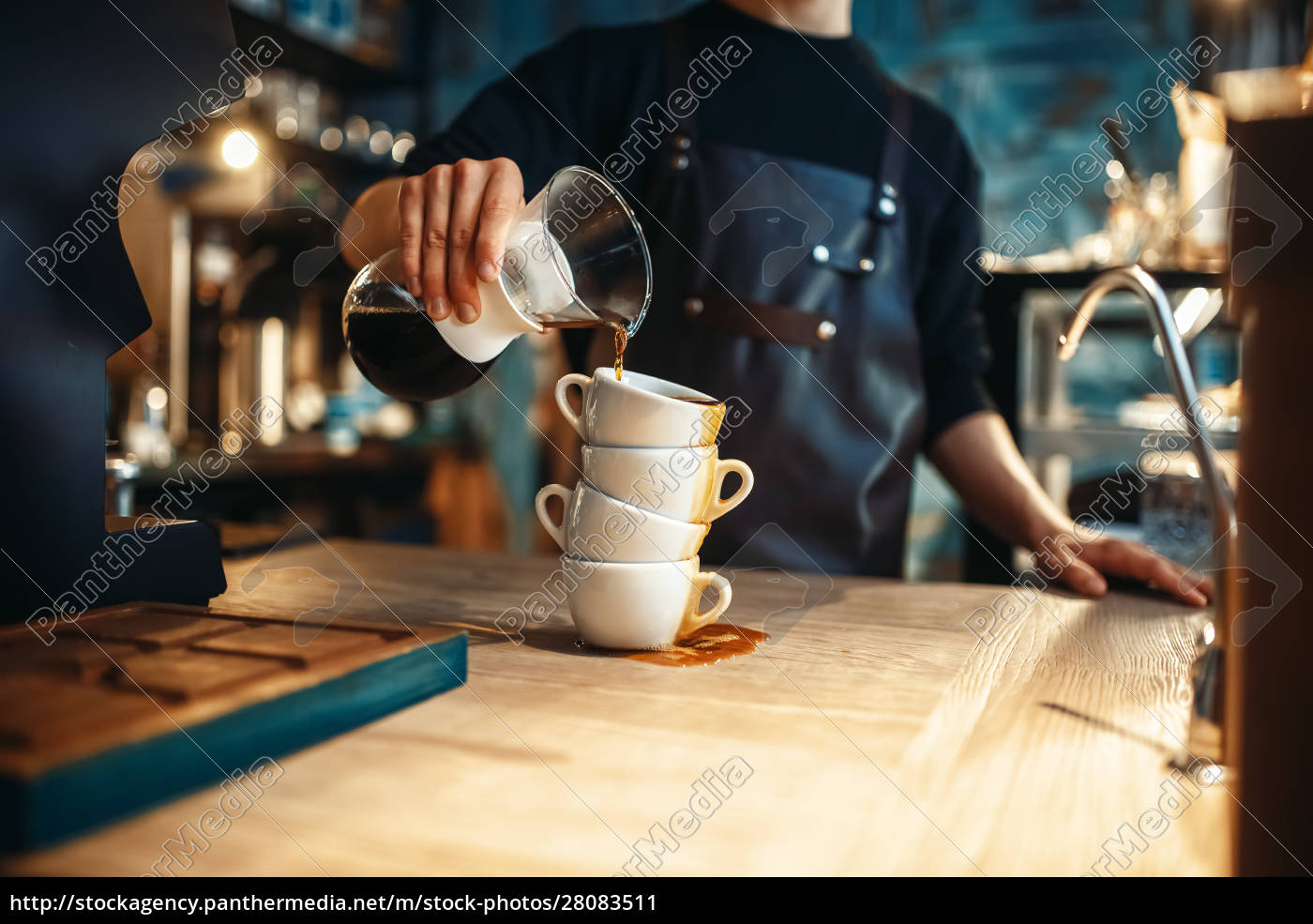 male, barista, pours, black, coffee, on - 28083511