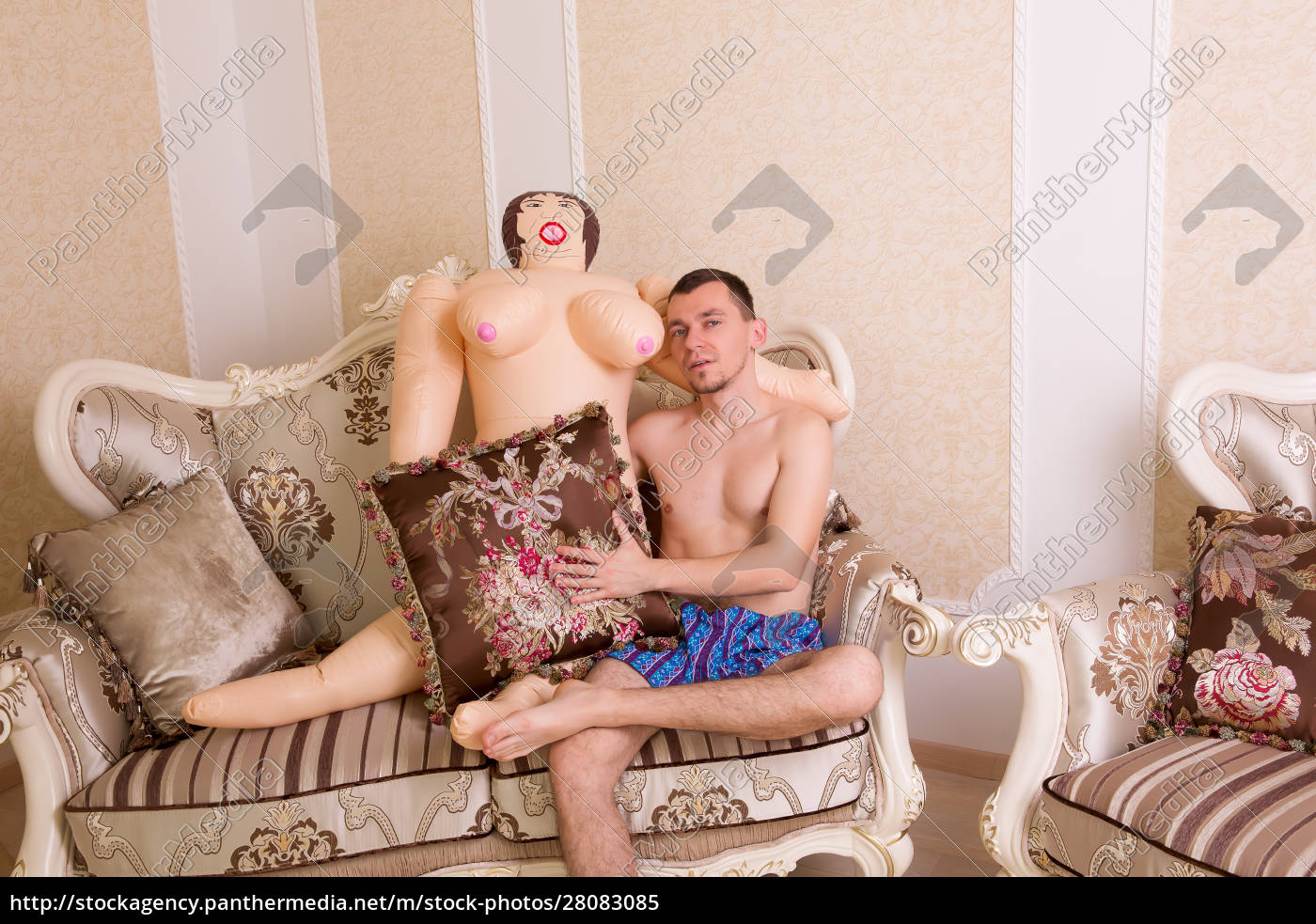 naked, man, with, sex, doll, sits - 28083085