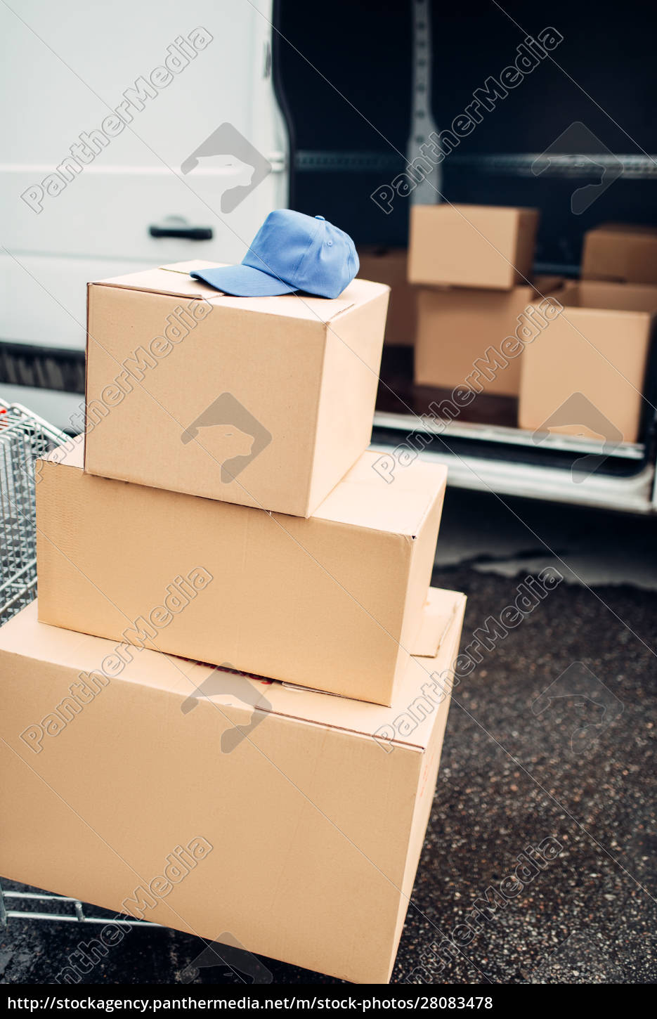 trolley, with, boxes, against, truck, , male - 28083478