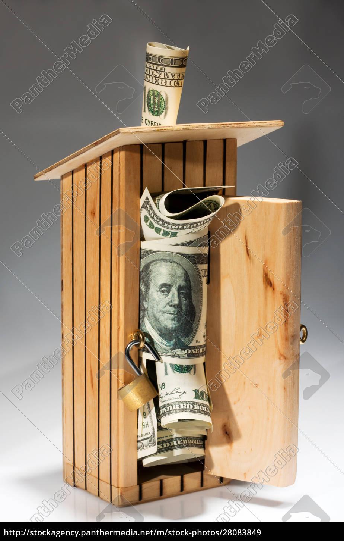 wooden, moneybox, full, of, money - 28083849