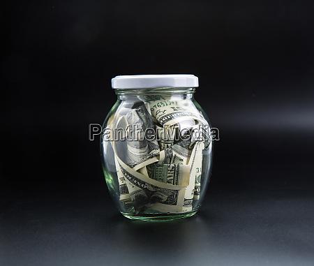 money saving concept glass jar full