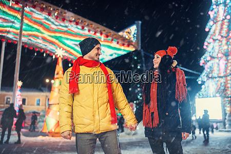 winter walk of couple illumination on