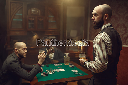three poker players sitting at the