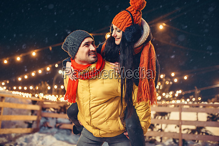 winter evening love couple having fun