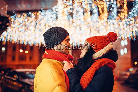 winter evening love couple hugs on