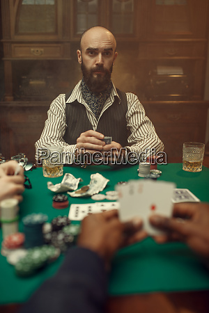 male hands with cards poker games