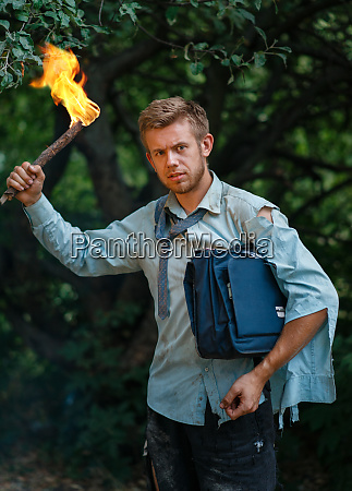 alone, businessman, with, torch, on, desert - 28084143