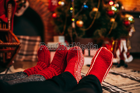 couple, feet, in, merry, red, socks, - 28084127