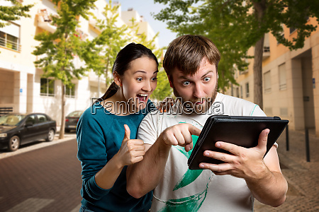 couple, playing, with, tablet, on, the - 28084099