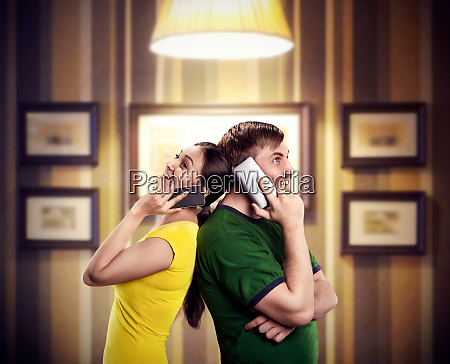 happy, couple, talking, by, phones - 28084012