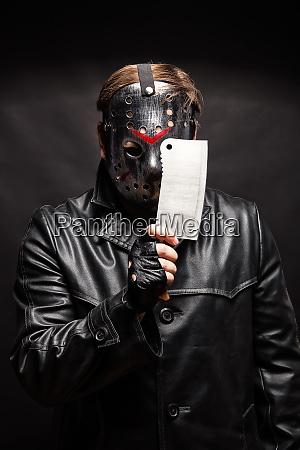 serial murderer with knife on black