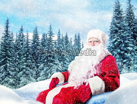 bearded santa claus in a red
