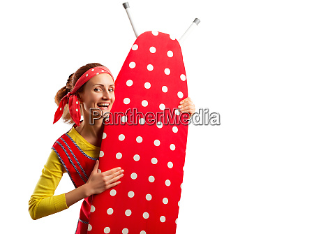 smiling housewife with ironing board