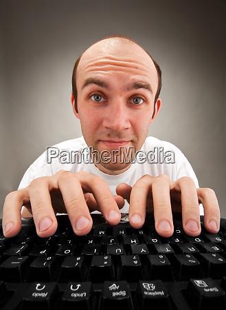 funny nerd working on computer