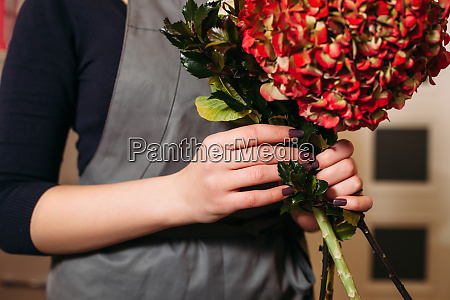 florist with beautiful bouquet of flowers