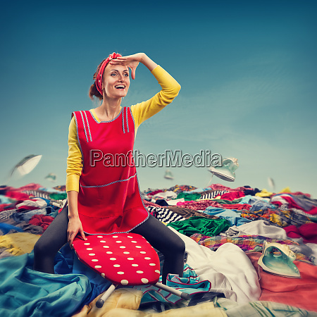 happy smiling housewife surfing on ironing