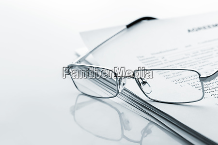 glasses lies on the newspaper