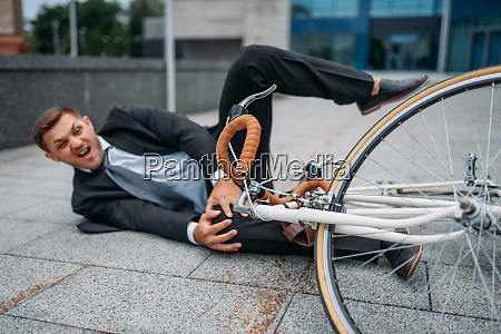 businessman fell off his bike at