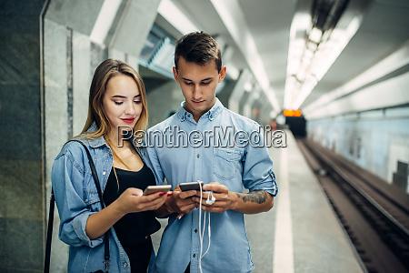 phone addict couple using gadget in