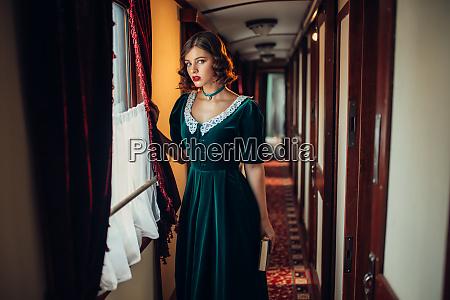 woman in retro dress vintage train