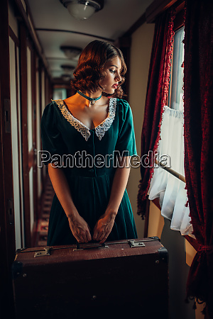 railway journey woman in vintage train