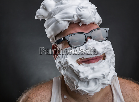 funny man with shaving foam covered