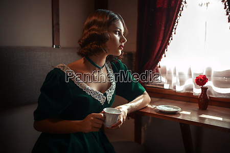 woman in vintage train rich compartment