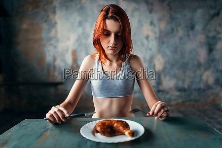 woman against plate with food absence