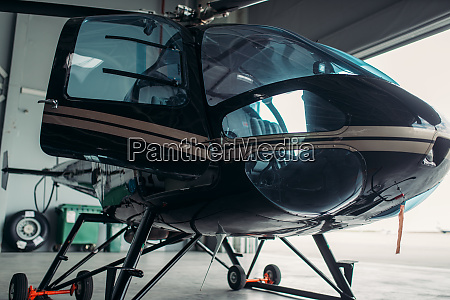 small helicopter in hangar private airline
