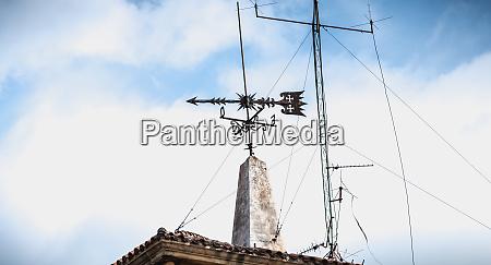 weathercock weathervane on the roof of