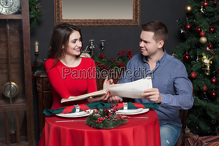 couple explore the menu at luxury