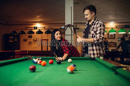 woman learn to play billiard poolroom
