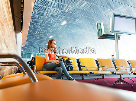 female traveller sitting with ticket in
