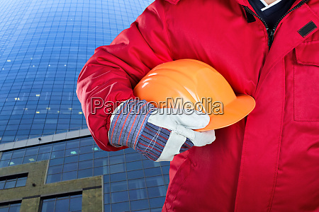 worker holding hardhat