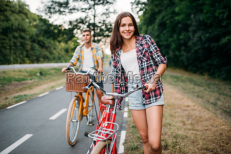 young man and woman walking on