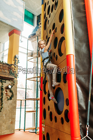 funny girl climbing walls in children