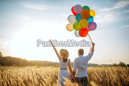 love couple with balloons leisure in