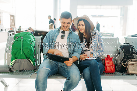 couple with luggage waiting for departure