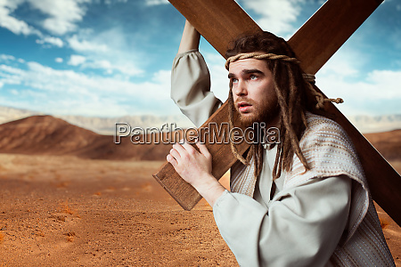 jesus christ with cross in desert